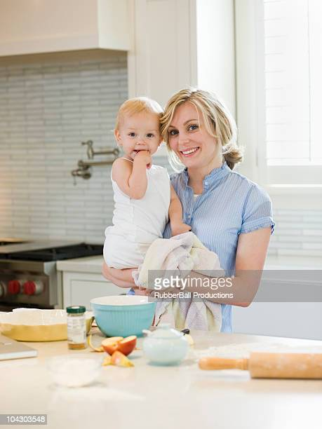 mother and baby girl cooking in the kitchen