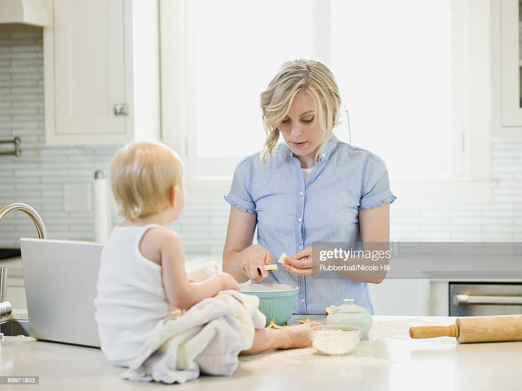 mother and baby girl cooking in the kitchen : Stock Photo
