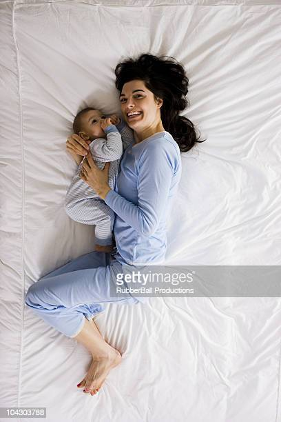 mother and baby in bed
