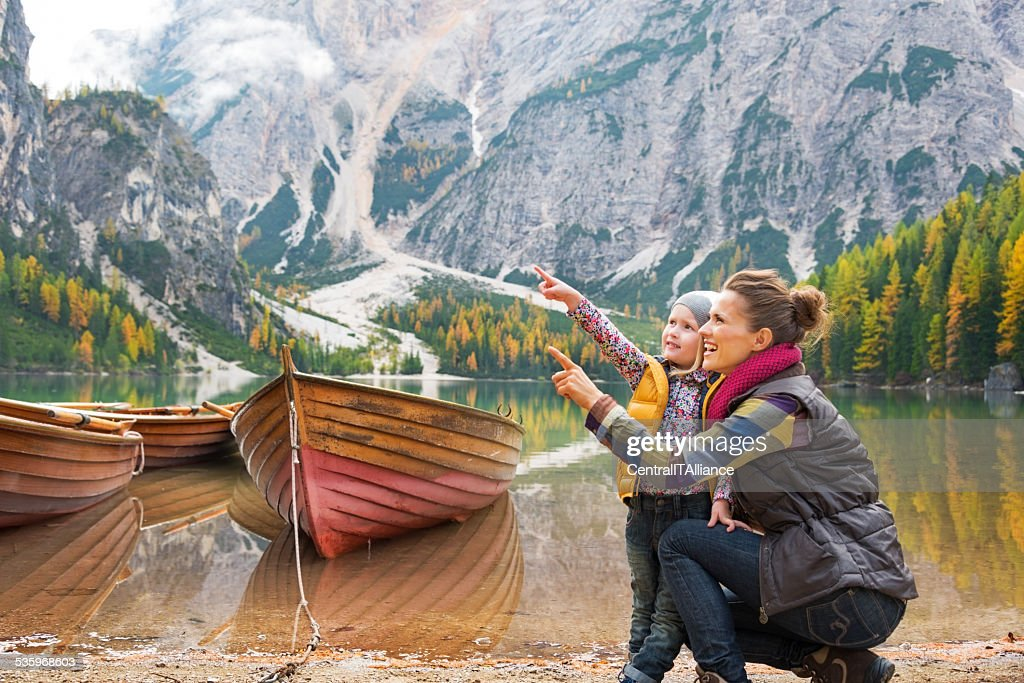 Mother and baby on lake braies in south tyrol, italy : Stock Photo