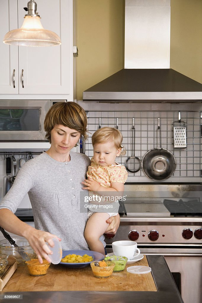 Mother and Baby Preparing Food : Stock Photo