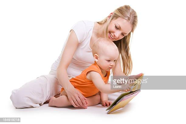 Mother and baby reading picture book together