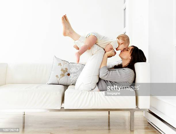 Mother and baby son on couch