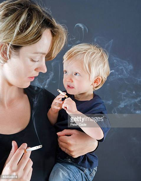 Mother and baby son smoking