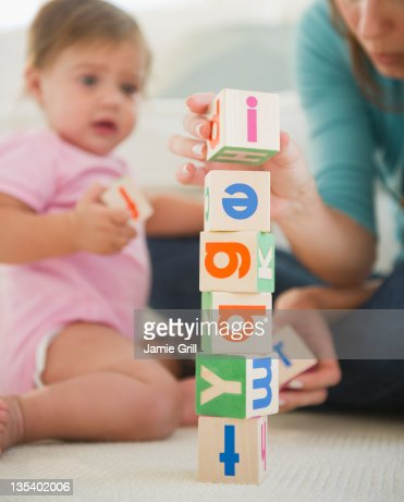 Mother and baby stacking blocks together : Stock Photo