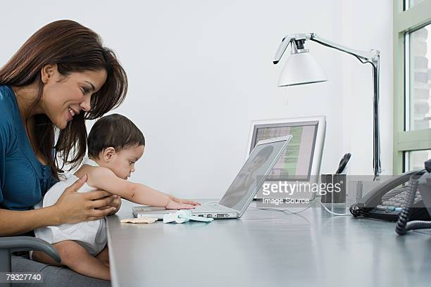 Mother and baby using a laptop computer