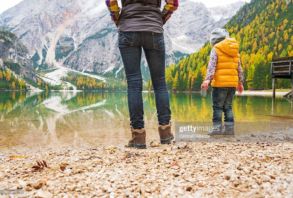 Mother and baby walking on lake braie, italy. Closeup : Stock Photo