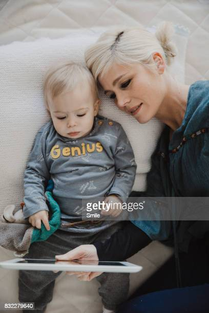 Mother and baby watching tablet