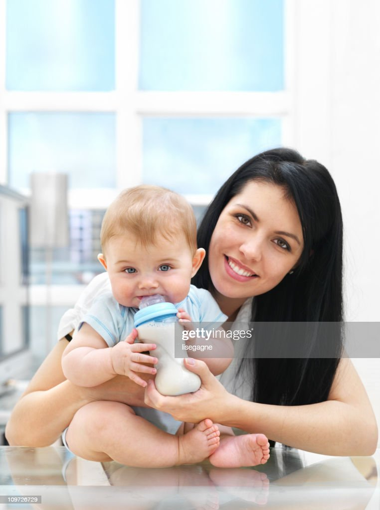 Mother and Baby with Bottle : Stock Photo