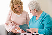 Mother and baby with home healthcare nurse
