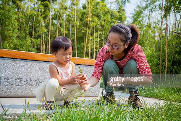 Mother and babygirl in park
