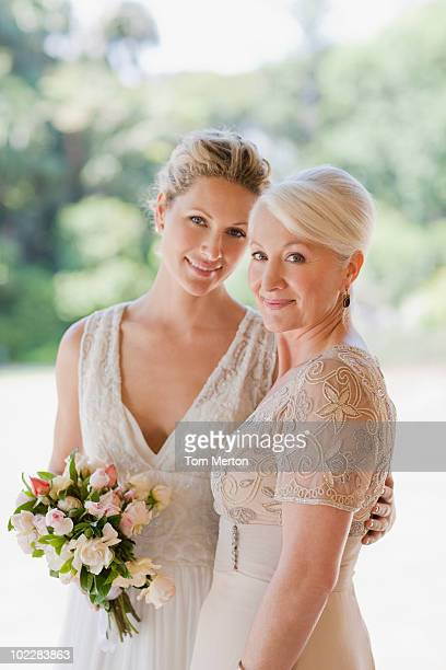 Mother and bride hugging
