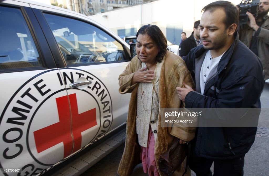 Mother and brother of the Indian-origin British doctor Abbas Khan, who died in Syrian prison, arrive Hotel Dieu de France Hospital in capital Beirut, Lebanon on December 21, 2013 to receive the body.