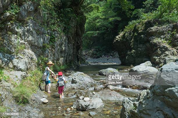 Mother and child exploring a river gorge, Japan