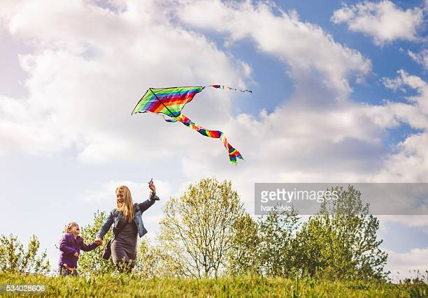 Mother and child flying kite together