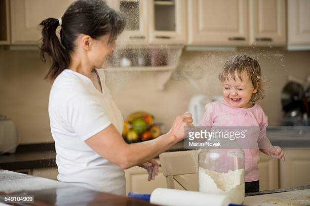Mother and child having fun with flour