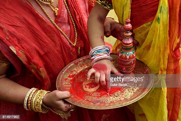 Mother and child holding tray contains vermilion during durga puja.
