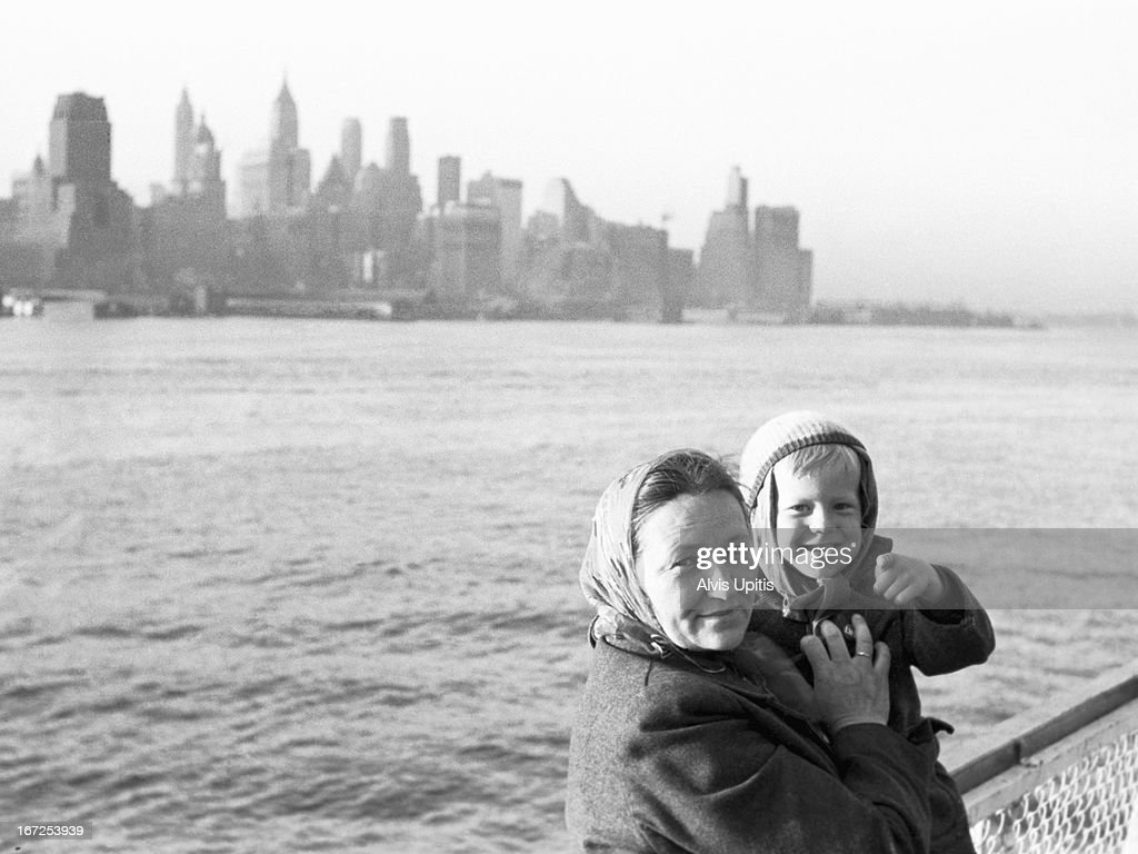 Mother and child immigrants arrive in NY Harbor : Photo