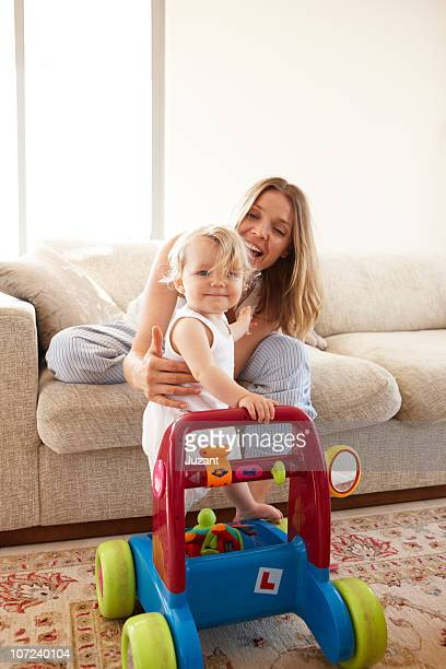 Mother and child in lounge room with toys