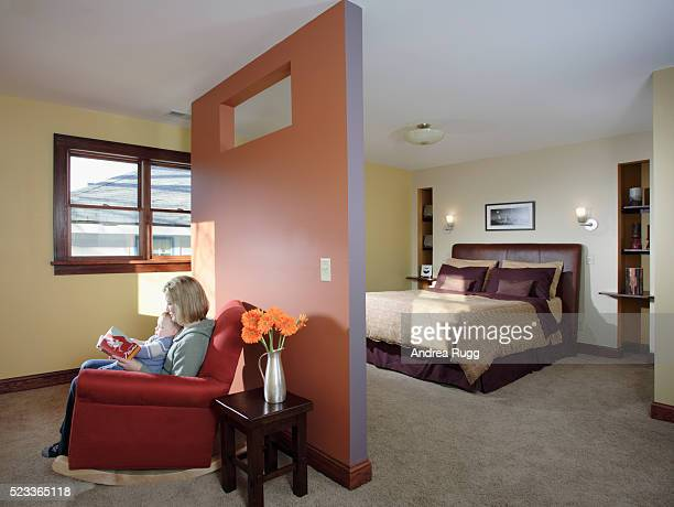 Mother and Child in Rocking Chair by Partition Wall
