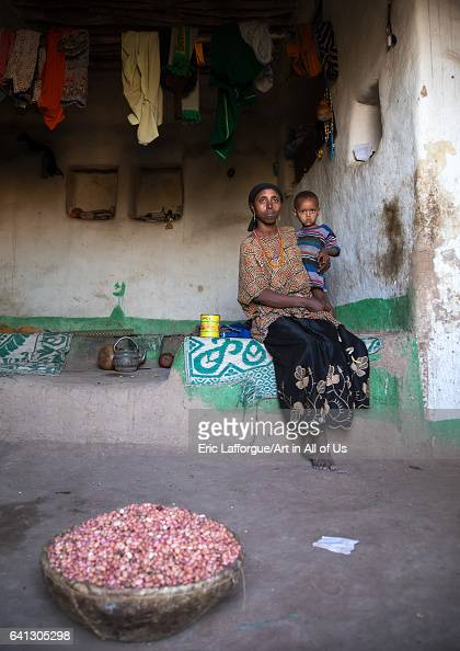 Mother and child inside their traditional Argoba stone house on January 12 2017 in Koremi Ethiopia