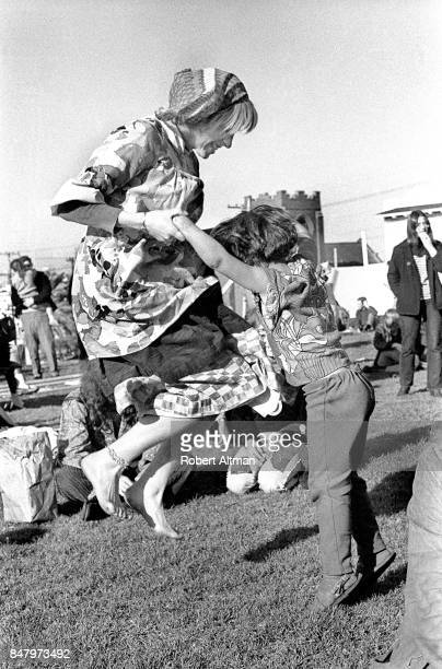 A mother and child 'Jump' around circa April 1969 at Delores Park in San Francisco California