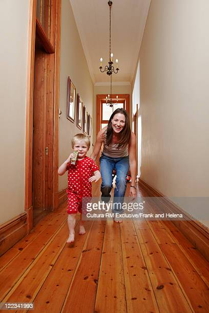 Mother and child playing in hallway