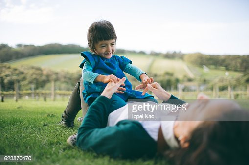 Mother and child playing on grass