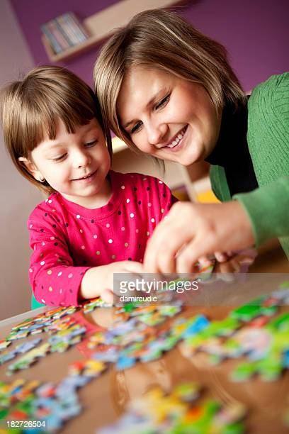 Mother and child playing with puzzle