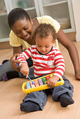 Mother and child playing with toy xylophone