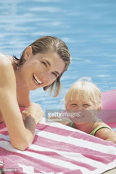 Mother and child poolside