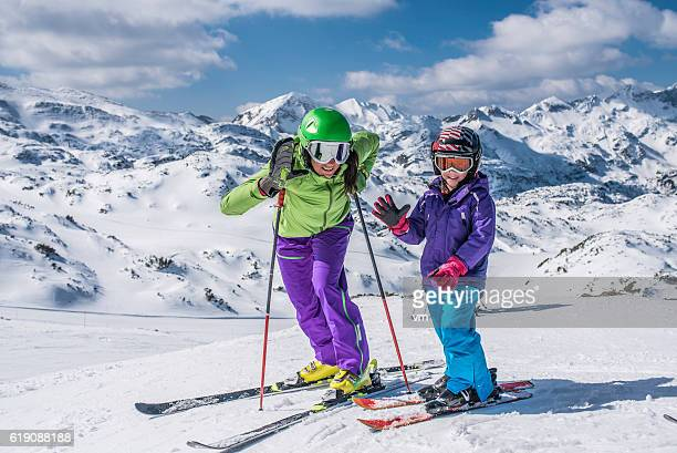 Mother and child portrait on ski slope