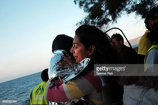A mother and child rejoice after arriving on a raft moments before from Turkey onto the island of Lesbos on October 17 2015 in Sikaminias Greece...