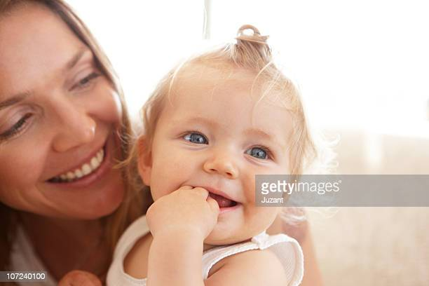 Mother and child smiling