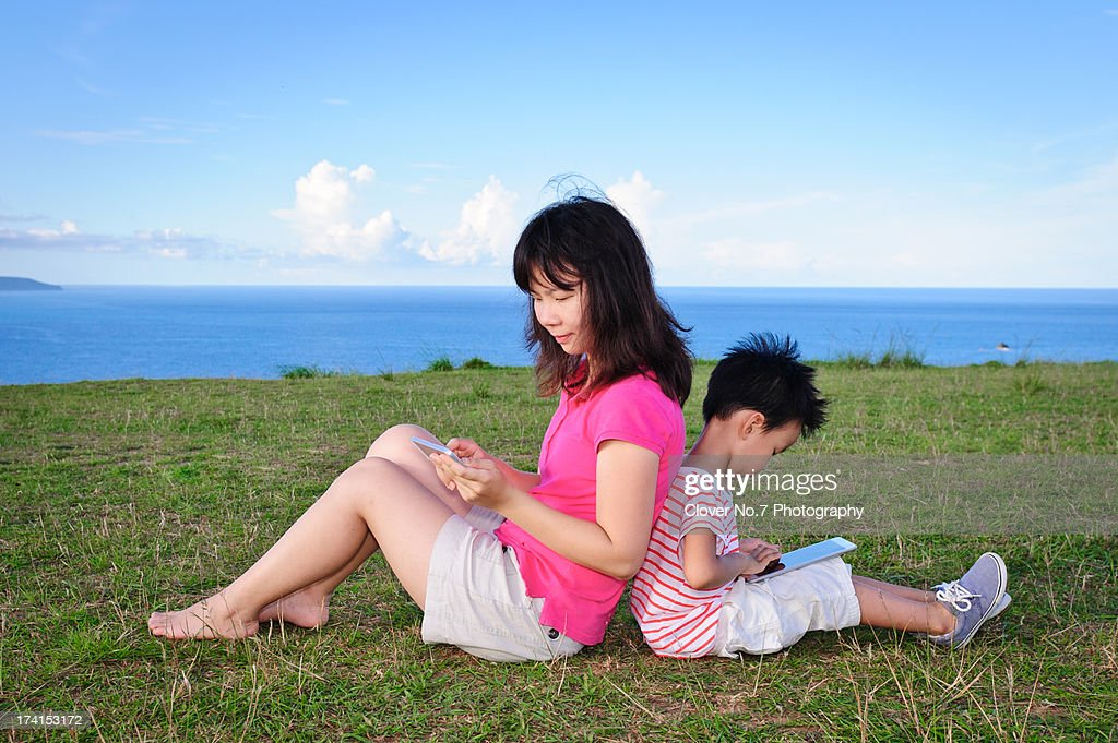 Mother and child using a digital tablet. : Stock Photo