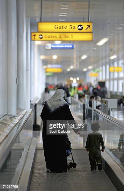 A mother and child walk towards their gate to catch a flight in the new Terminal 3 Pier 6 at London Heathrow Airport on May 18 2006 in London England...
