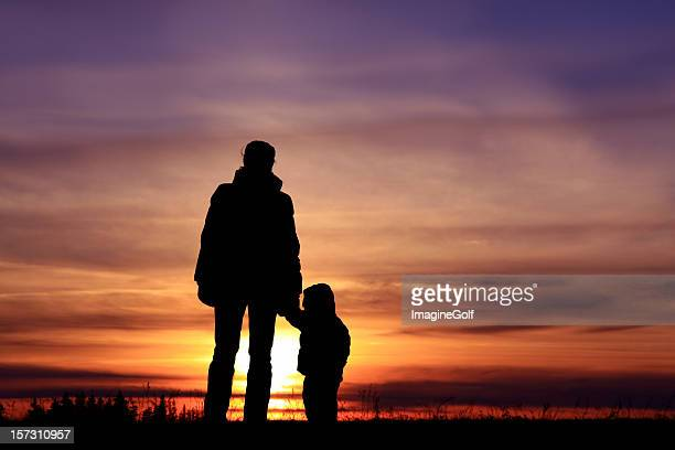 Mother and Child Watching the Sunset Bonding