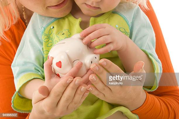 Mother and child with a piggy bank