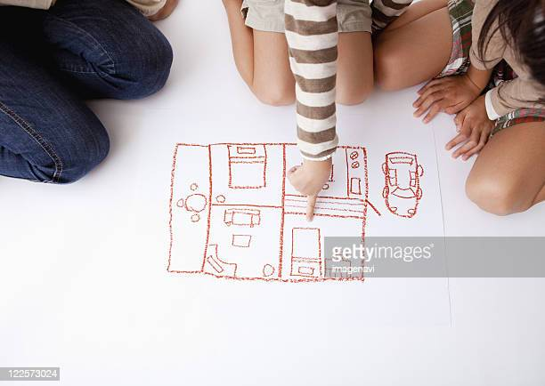 Mother and children and a pictuere of room layout