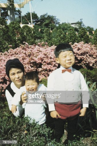 Mother and children at a park : Stock Photo
