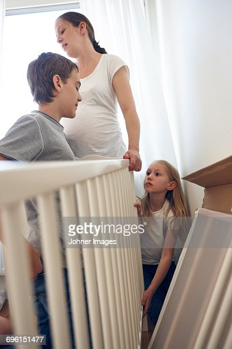 Mother and children building cot