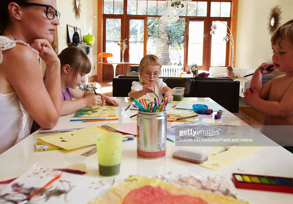 Mother and children drawing together : Stock Photo