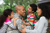 Mother and children greeting soldier