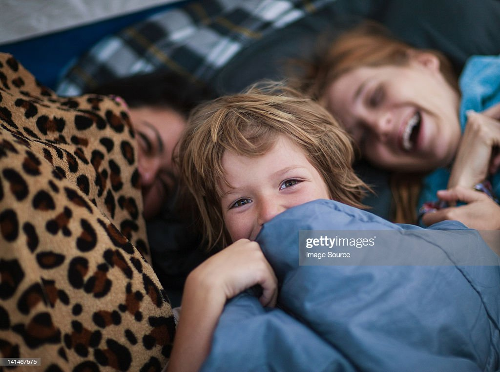 Mother and children in a tent : Stock Photo