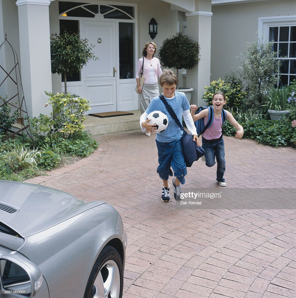 Mother and Children Leaving : Stock Photo