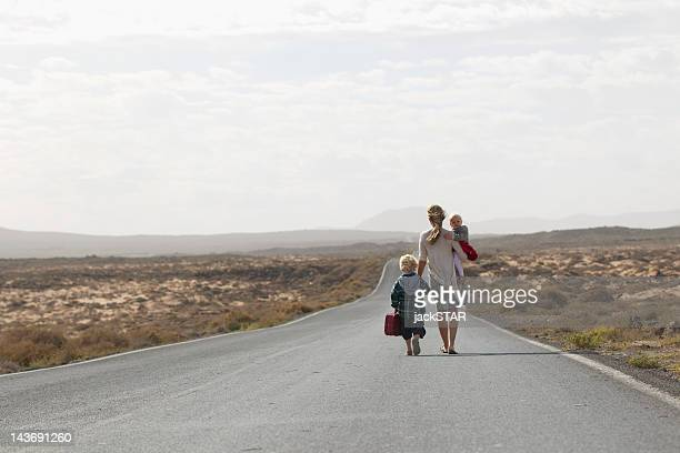 Mother and children on rural road