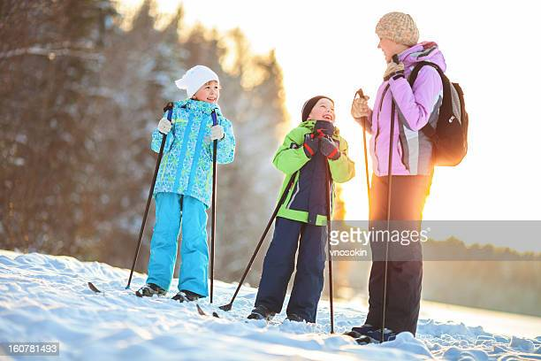 Mother and children on ski