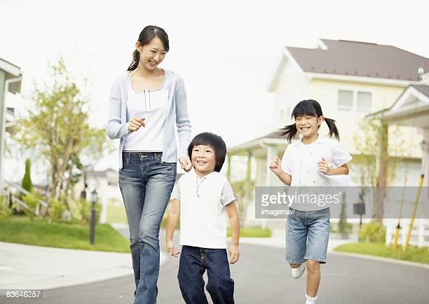 Mother and children running