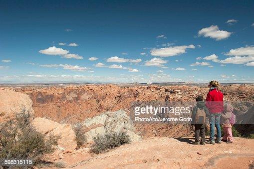 Mother and children standing at edge of canyon in Canyonlands National Park, Utah, USA