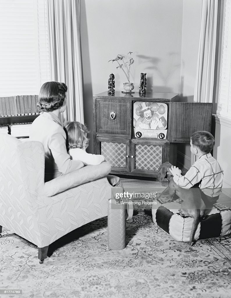 Mother and children watching television. : Stock Photo